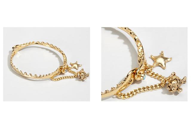 Le bracelet mâchoire de requin de Disney Couture