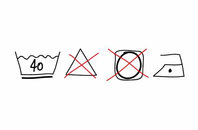 Que veulent dire ces mystérieux symboles sur les étiquettes de mes vêtements ?